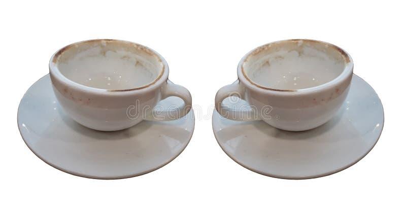 Dos utilizaron la taza de café vacía aislada en los fondos blancos foto de archivo