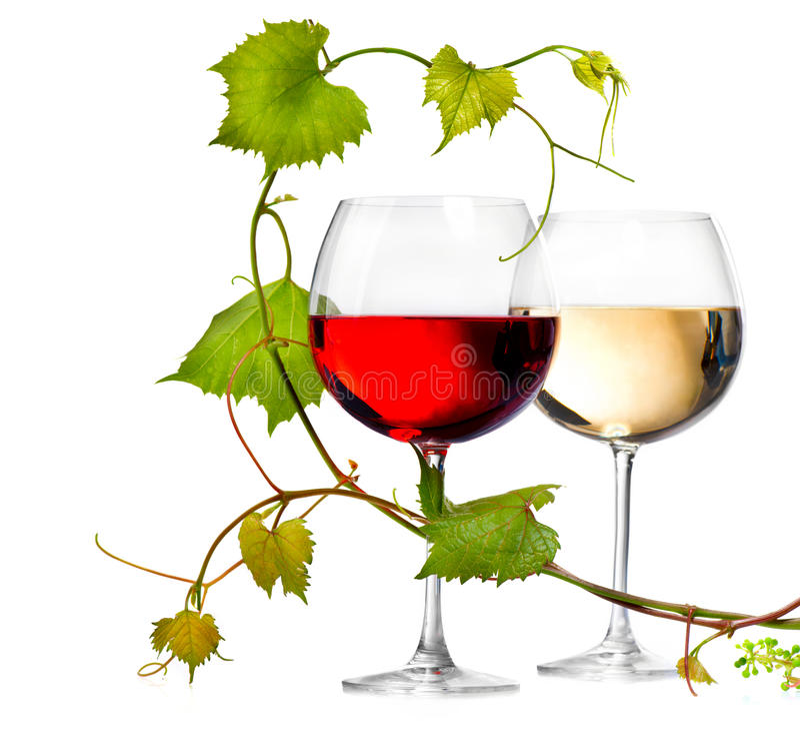 Dos vidrios de vino blanco rojo y imágenes de archivo libres de regalías