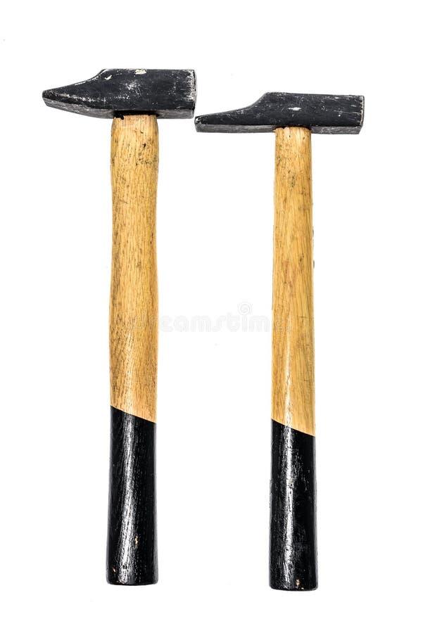 Dos viejos, martillos usados aislados en un fondo blanco fotos de archivo