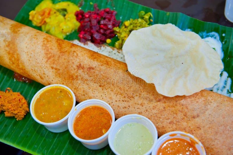 Dosa, crispy savory pancake from South India.  stock photos