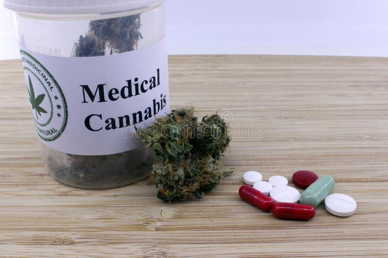 Dosage of medical marijuana and pills royalty free stock photography