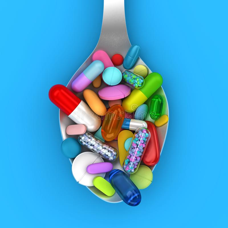 Dose de pilules color?es dans la cuill?re photos libres de droits
