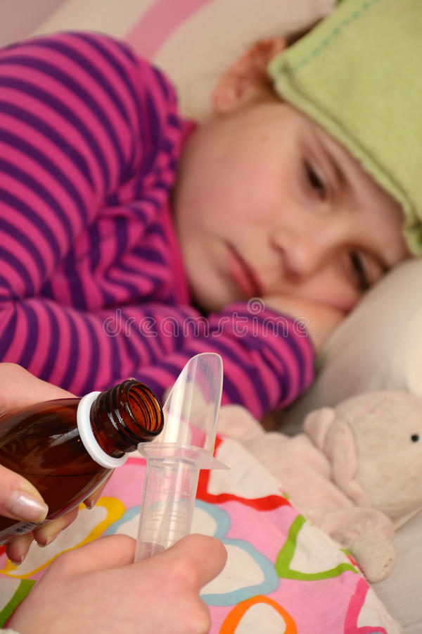 Dosing Medication For Sick Girl Stock Photos