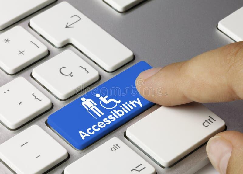 Dostępność - Napis na kluczu niebieskiej klawiatury zdjęcie royalty free