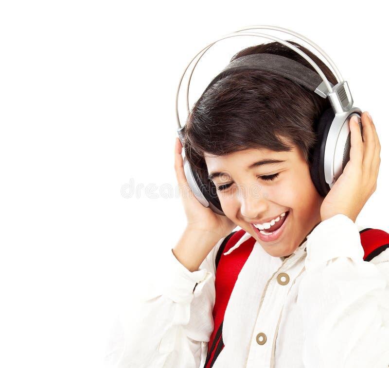 Dosyć nastoletniej chłopiec cieszy się muzyka zdjęcia stock