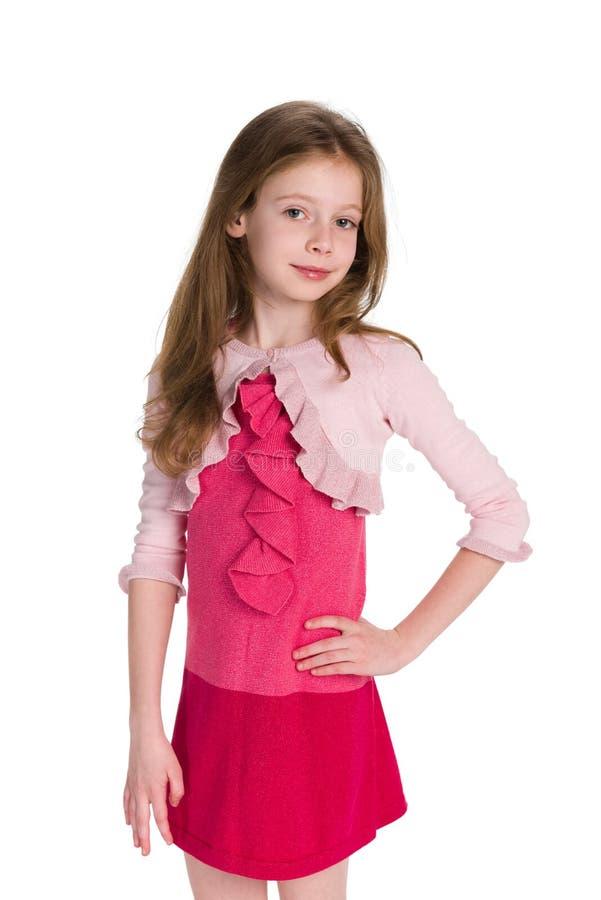 Dosyć uśmiechać się mała dziewczynka stojaki zdjęcie royalty free