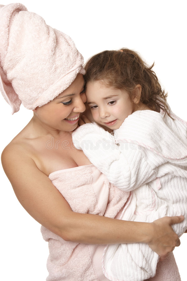 Doting mother and daughter bathtime. Caring nurturing mother cuddles her daughter at bathtime royalty free stock photography