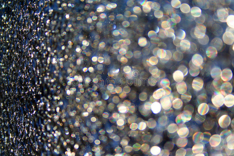 dots of light and cracks on the glass royalty free stock photo