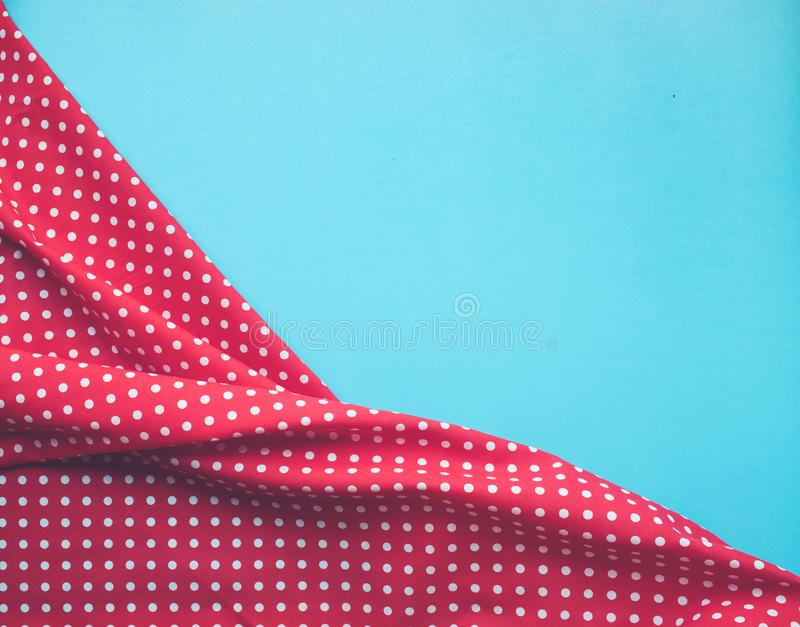 Dots red fabric cloth with blue background. stock photo