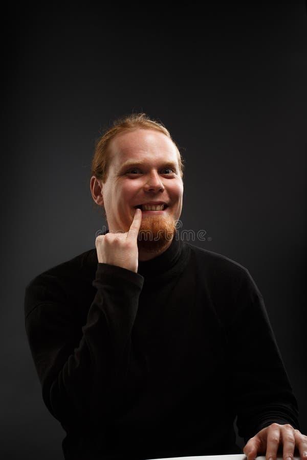 Dott. dai capelli rossi sorridente Evil fotografia stock