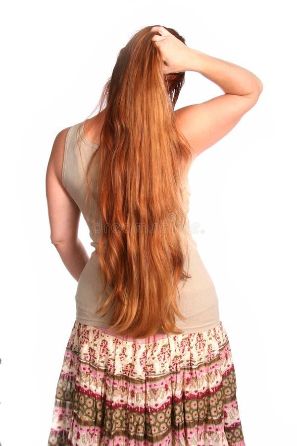 dotykaj włosów kobiety jazdy fotografia royalty free