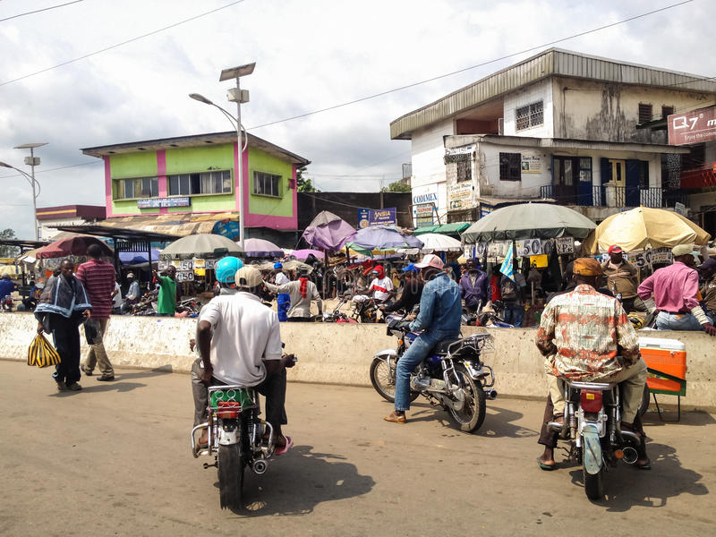 Douala, Cameroon. NOVEMBER 5, 2013: Unidentified people on thje street of . With more than 3 million inhabitants it is a largest city in Cameroon and its royalty free stock photography