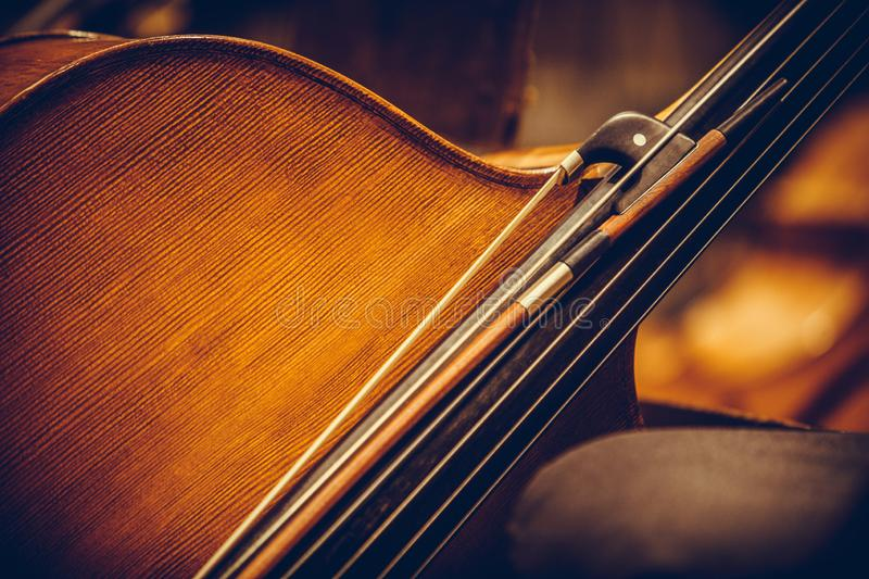 Double bass and bow. Close up shot of a double bass and a bow royalty free stock photography