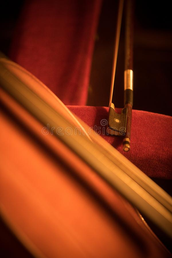 Double bass and bow. Close up shot of a double bass and a bow stock photos