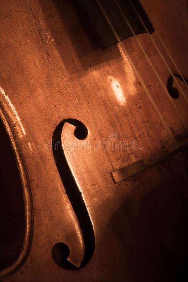 Double bass f hole. Close up shot of a double bass f hole stock images