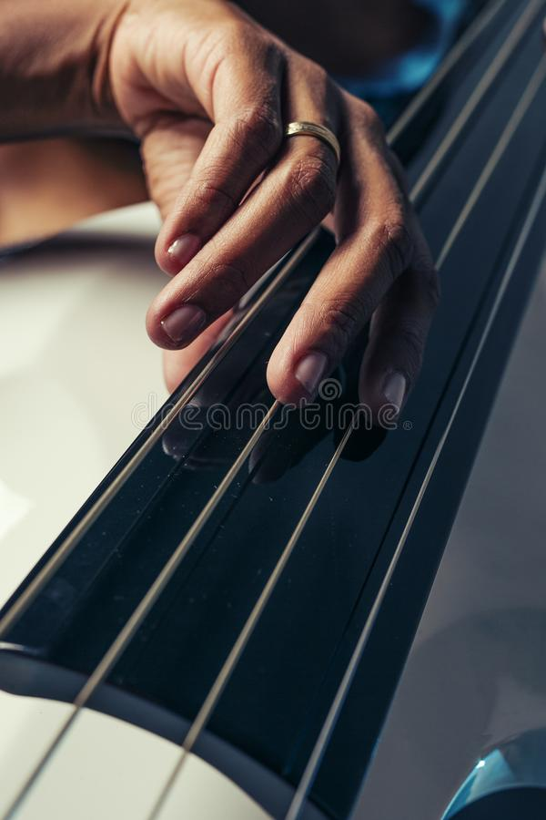 Double bass. Hands playing contrabass player musical instrument. royalty free stock images