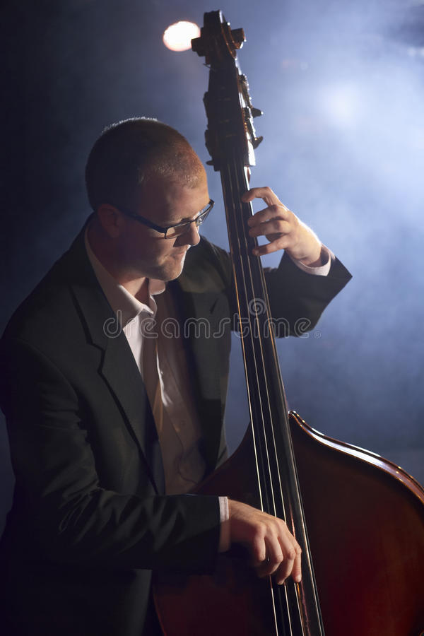 Download Double Bass Player On Stage Stock Image - Image of bald, performer: 31835785