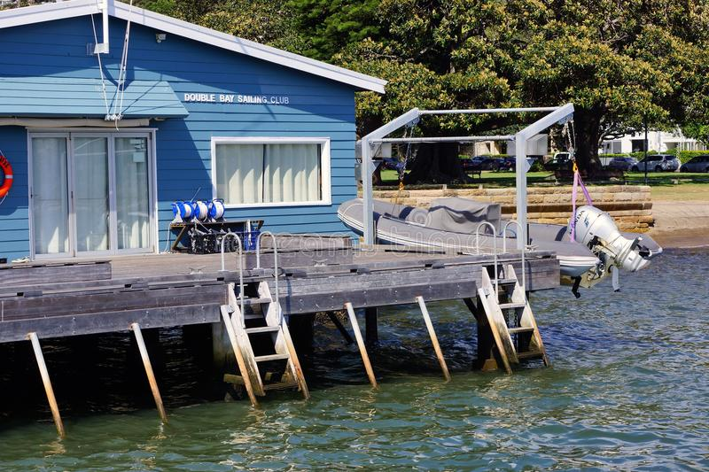 Double Bay Sailing Club, Sydney Harbour, Australia. Blue painted Double Bay Sailing Club building on a wooden wharf or pier, Double Bay, Sydney Harbour, Sydney royalty free stock photo