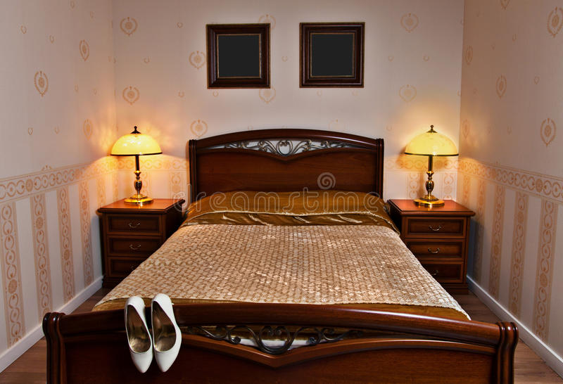 Double bed in the hotel room royalty free stock images