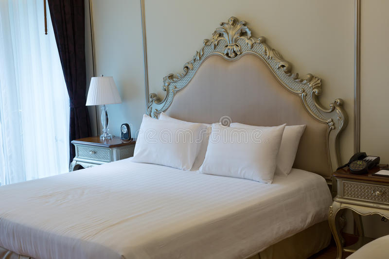 Double bed in the hotel room royalty free stock photography