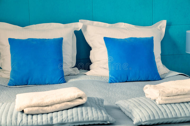 Double bed in hotel room. Accommodation stock images
