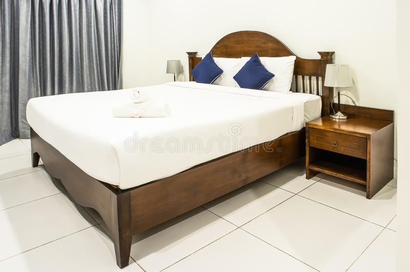 Double bed in hotel room stock photo