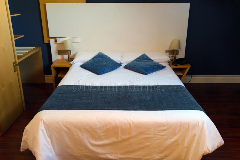 Double bed in a hotel room royalty free stock image