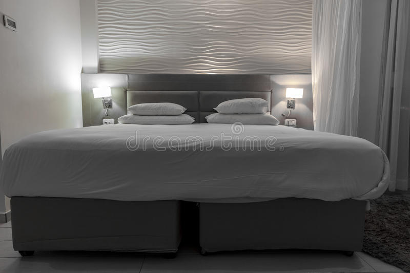 Double Bed In A Hotel Room With Night Lights Stock Photo