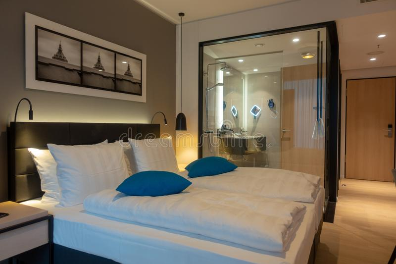 Double bed in a luxurious hotel room stock images