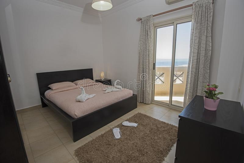 Double bed in a luxury apartment with sea view stock image