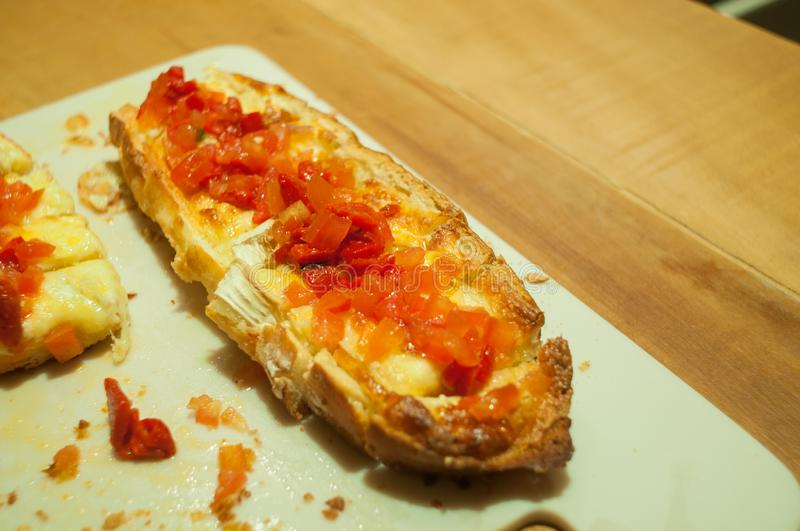Double brusqueta with italian tomatoes and cheese, on the table, 45 degree angle stock photo