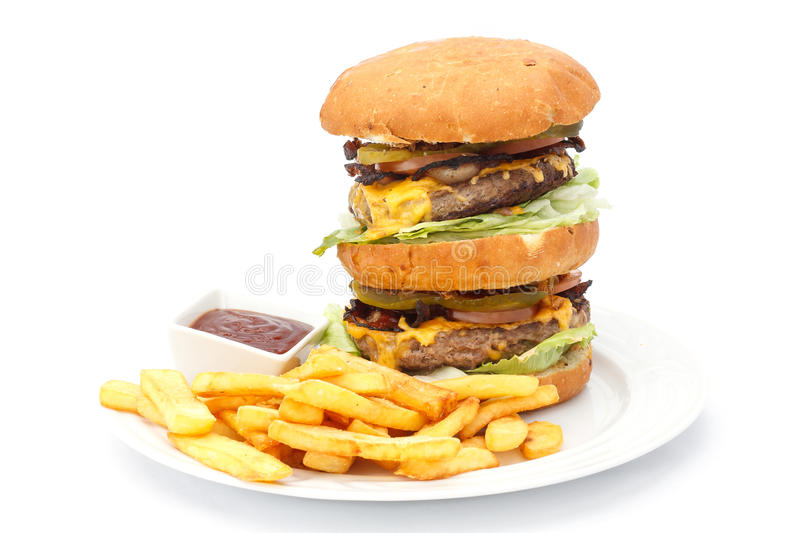 Double cheese burger and chips with ketchup royalty free stock photography