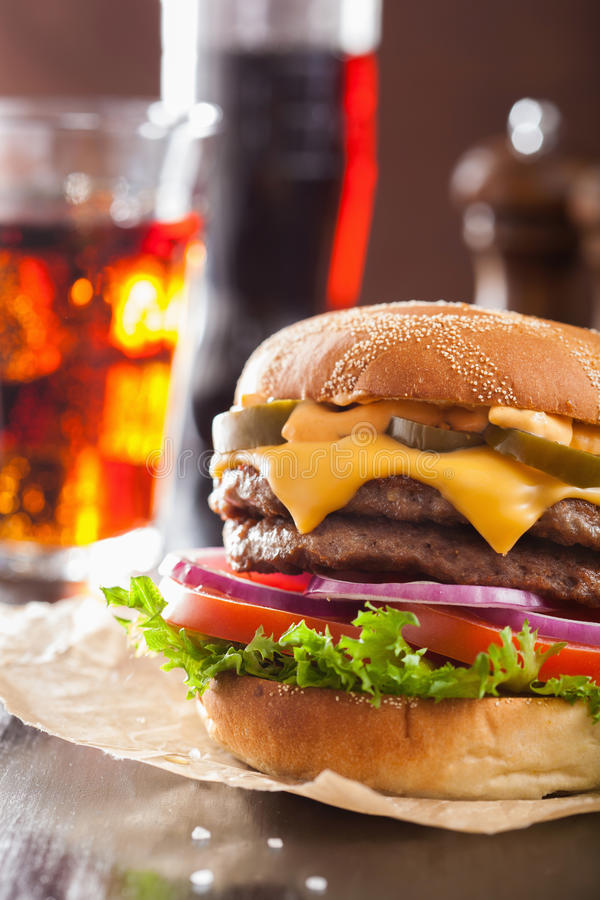 Double cheese burger with jalapeno tomato onion.  royalty free stock photo