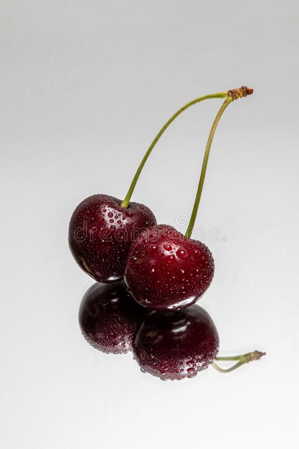 Double Cherry with reflection on a light background royalty free stock images