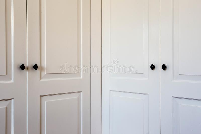 Double closet doors interior design modern white close-up. Wooden royalty free stock photo