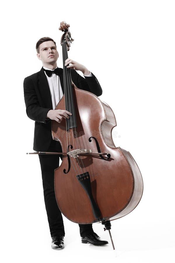 Double contrebasse de bassiste d'isolement photo stock