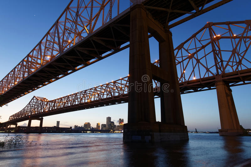 Double Crescent City Connection Bridge at the blue hour. The Crescent City Connection Bridge on the Mississippi river at the blue hour royalty free stock photo