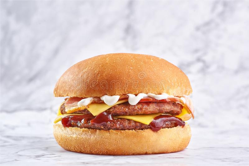 Double cutlet burger with double cheese and bacon stock image