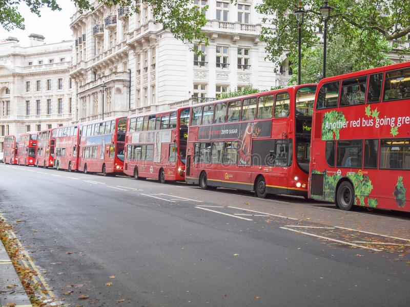 Double decker bus. LONDON, ENGLAND, UK - OCTOBER 23: Row of double decker red buses waiting to depart from on October 23, 2013 in London, England, UK stock images