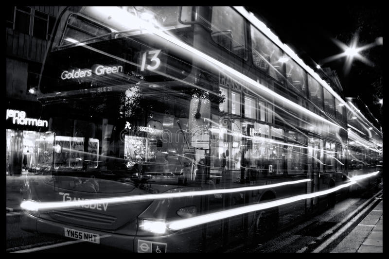 Double decker bus at night Oxford Street with light trails royalty free stock image
