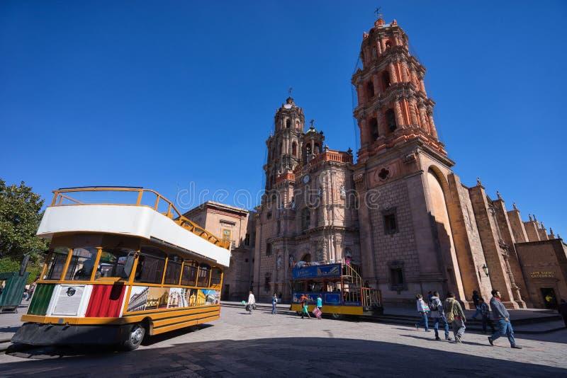 Double decker tourist tour bus in San Luis Potosi, Mexico. January 18, 2016 San Luis Potosi, Mexico: double deck tourist tour bus in the historic center of the stock image