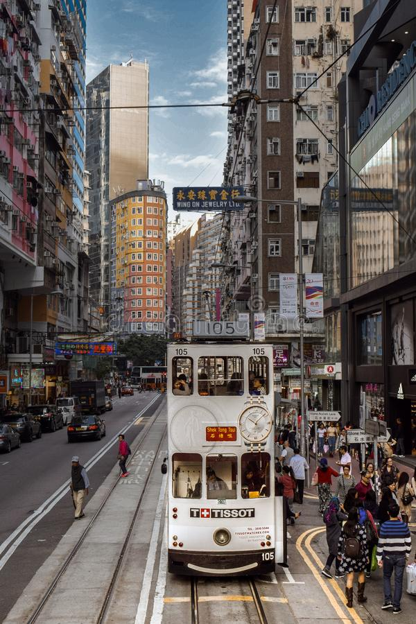 Double-decker tram on a busy street of the Hong Kong Island in China royalty free stock photography
