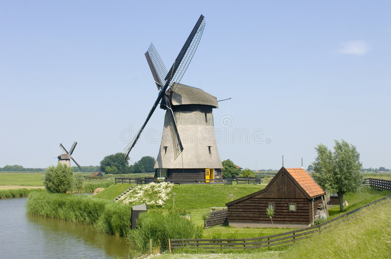 Double Dutch windmills royalty free stock photography