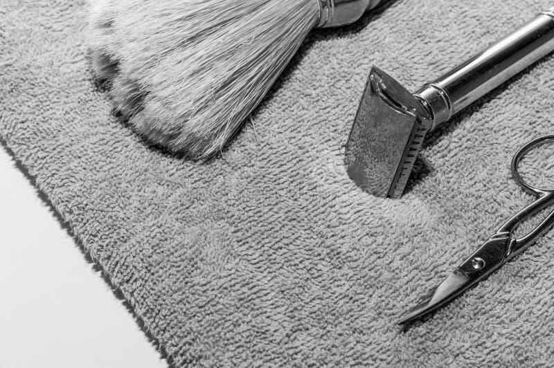 Double edge razor, brush and scissors. royalty free stock photo