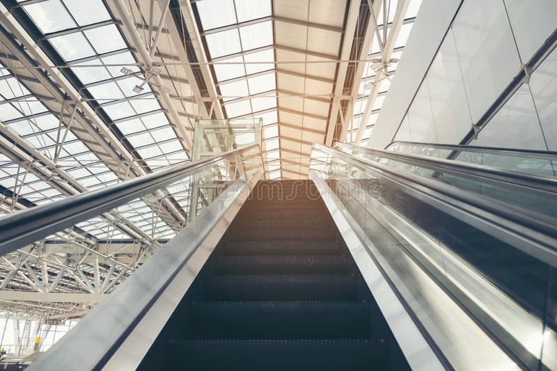 Double Escalator going up. Moving up staircase escalator. floor platform electric escalator. Thai royalty free stock image