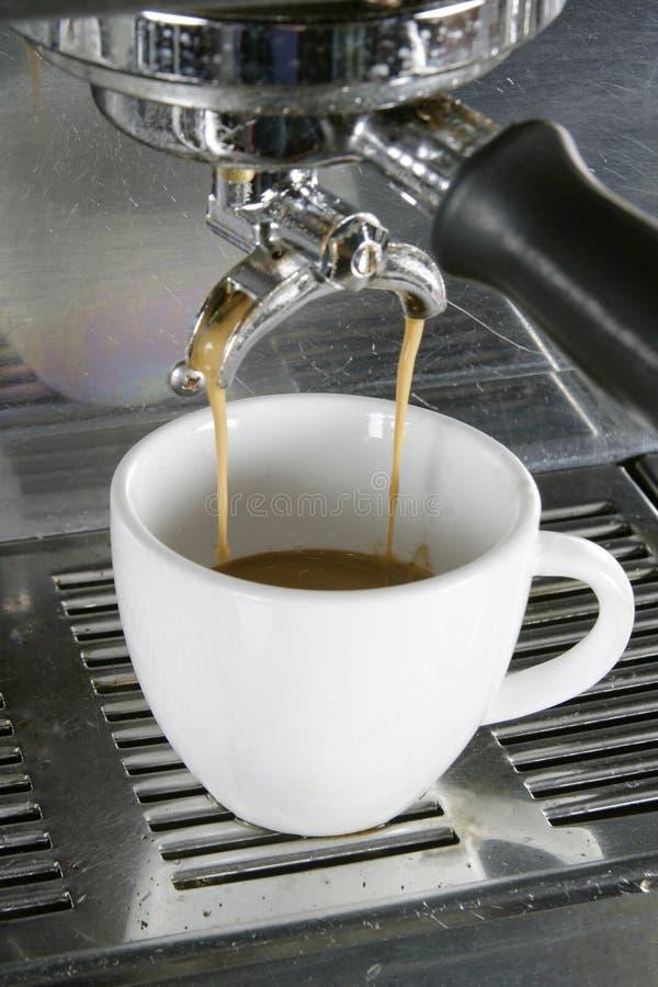 Double Espresso. Drawing a double into an espresso, americano, or cappuccino cup stock photo