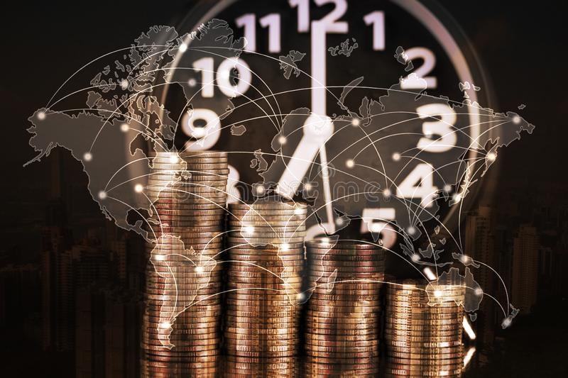 Double exposure of Alarm clock and step of coins stacks, time for savings money, world map, global network business banking royalty free stock photos