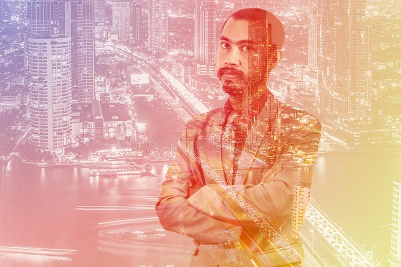 Double exposure of asian business man with Bangkok city royalty free stock photography