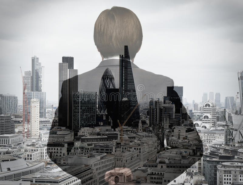 Double exposure of back view of success businessman stock image