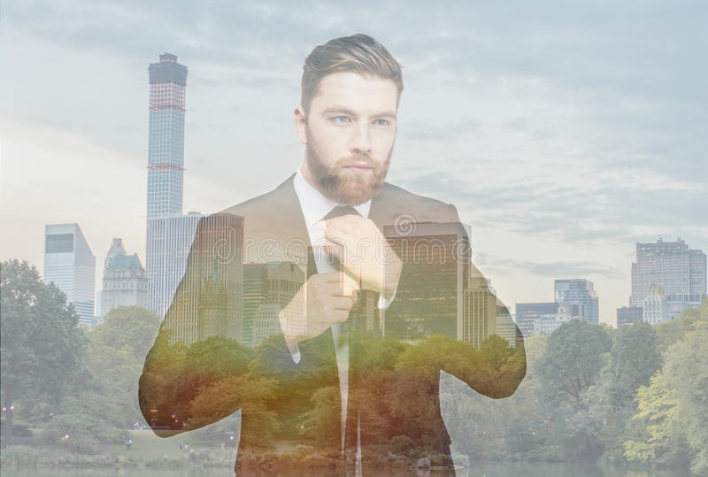 Double exposure of bearded businessman stock images